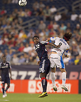 New England Revolution midfielder Joseph Niouky (23) and Puebla FC forward Gabriel Pereyra (8) battle for head ball. The New England Revolution defeated Puebla FC in penalty kicks, in SuperLiga 2010 semifinal at Gillette Stadium on August 4, 2010.