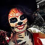 A young girl, representing a Mexican cultural icon called La Calavera Catrina, takes a part in celebrations of the Day of the Dead (Día de Muertos) holiday in Morelia, Michoacán, Mexico, 31 October 2014.