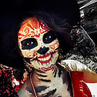 A young girl, representing a Mexican cultural icon called La Calavera Catrina, takes a part in celebrations of the Day of the Dead (Día de Muertos) holiday in Morelia, Michoacán, Mexico, 31 October 2014.