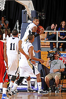 21 January 2012:  FIU guard Jeremy Allen (32) pulls down a rebound in the second half as the Florida Atlantic University Owls defeated the FIU Golden Panthers, 66-64, at the U.S. Century Bank Arena in Miami, Florida.