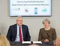 (L-R) First Minister for Wales Carwyn Jones signs with Britain Prime Minister Theresa May during the Bay City Region deal, at the Liberty Stadium, Swansea, Wales, UK. Monday 20 March 2017.