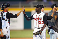 Lansing Lugnuts outfielder Anthony Alford (22) high fives catcher Michael De La Cruz (7) after a game against the Peoria Chiefs on June 6, 2015 at Cooley Law School Stadium in Lansing, Michigan.  Lansing defeated Peoria 6-2.  (Mike Janes/Four Seam Images)