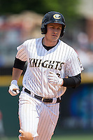 Jason Coats (17) of the Charlotte Knights rounds the bases after hitting a solo home run against the Gwinnett Braves at BB&T BallPark on May 22, 2016 in Charlotte, North Carolina.  The Knights defeated the Braves 9-8 in 11 innings.  (Brian Westerholt/Four Seam Images)