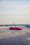 Aerial view of The Odfjell Group's tanker in the Icy waters of the Delaware River, Penns Landing and Camden, New Jersey in background, along with the Walt Whitman Bridge, just outside of Philadelphia, Pennsylvania, USA
