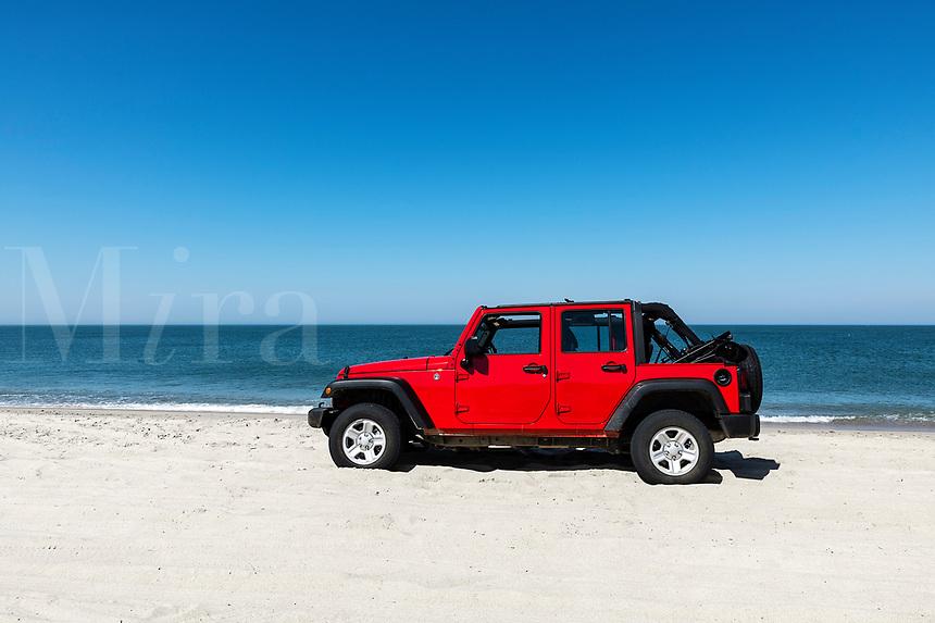 Parked SUV, Great Point Beach, Nantucket, Massachusetts, USA.