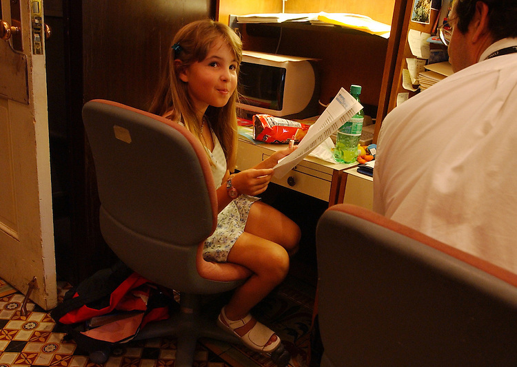 reporter2/072803 - Alexandria Jansen, 7, looks over a story on the GAO written by her dad, Bart Jansen, writer for the Portland Press Herald, in the Senate Press Gallery, Monday.   Jansen was babysitting for the day.