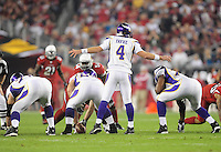 Dec 6, 2009; Glendale, AZ, USA; Minnesota Vikings quarterback (4) Brett Favre calls a play against the Arizona Cardinals at University of Phoenix Stadium. The Cardinals defeated the Vikings 30-17. Mandatory Credit: Mark J. Rebilas-