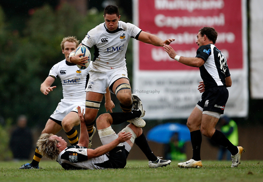 Photo: Richard Lane/Richard Lane Photography. Rugby Roma v London Wasps. Amlin Challenge Cup. 17/10/2009.   Wasps' Dan Leo runs over Roma's Michael Aldridge in attacks.