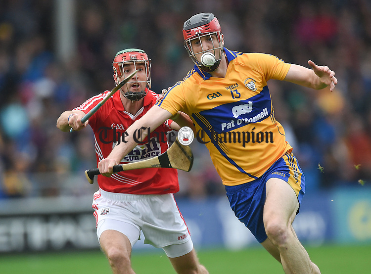 Darach Honan of Clare in action against Stephen Mc Donnell of Cork during their All-Ireland qualifier game in Thurles. Photograph by John Kelly.
