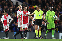 Referee Gianluca Rocchi explains to Dusan Tadic of Ajax that Var is checking whether Chelsea's fifth goal will stand during Chelsea vs AFC Ajax, UEFA Champions League Football at Stamford Bridge on 5th November 2019