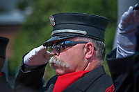 Westerville Fire Fighter Tom Ullom salutes during TAPS at First Responders Park in Westerville, OH, during ceremonies marking the 10th anniversary of the attack on the World Trade Center