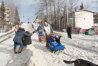 Noah Pereira and team run past spectators on the bike/ski trail with an Iditarider in the basket during the Anchorage, Alaska ceremonial start on Saturday, March 5, 2016 Iditarod Race. Photo by O'Hara Shipe/SchultzPhoto.com