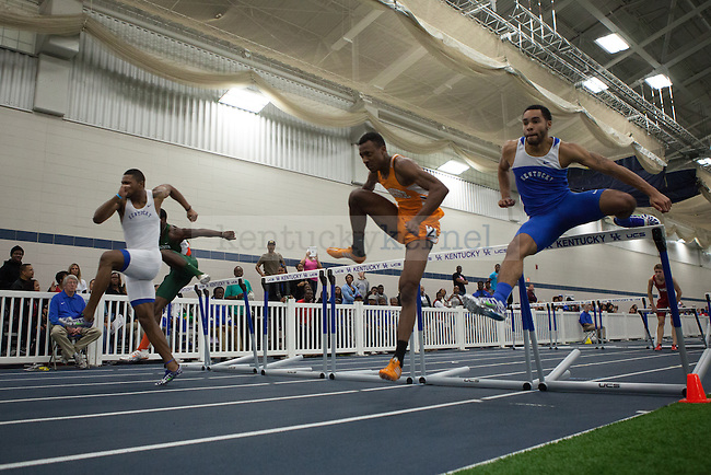 UK junior Barryl Bradshaw (left), Tennessee senior Terry Benson (center), and UK junior Brandon Bagley (right) during the men's 60 meter hurdles finals during the UK Invitational Track & Field Meet on January 12th, 2013 at the Nutter Field House. Photo by Adam Chaffins | Staff