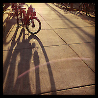 The sun casts a shadow of a moped locked up on 50th Street in the West Philadelphia neighborhood of Cedar Park on January 10, 2013.