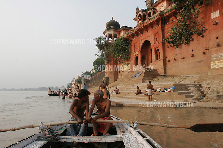 .VARANASSI, UTTAR PRADESH, INDIA - OCTOBER 3, 2005 : Hindu pilgrims bathe at sunrise in the Ganges river to wash away their sins in the holy Hindu city of Varanassi on october 3, 2005. Varanassi (also called Benares or Kachi) is one of the holiest city in India and has always been an auspicious place to die, since expiring here offers moksha - liberation from the cycle of birth and death. (Photo by Jean-Marc Giboux)