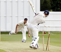 Zak Khan (L) of Hampstead clean bowls Nick Brand during the ECB Middlesex Premier League game between North Middlesex and Hampstead at Park Road, Crouch End on Saturday May 17, 2014