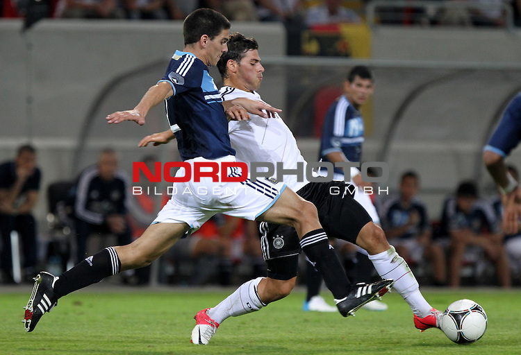 14.08.12, Offenbach am Main, Stadion Bieberer Berg, Sparda Bank Hessen Stadion, GER, U21,  Deutschland vs Argentinien , <br />  im Bild  Kevin Volland (GER) gegen Lisandro Magallan (ARG)<br /> <br />  // during the match between Deutschland and Argentinien U21 on 2012/08/14 <br />   Foto &copy; nph / Hessland
