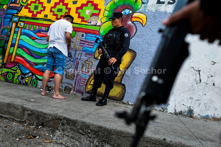 An alleged gang member is controlled by a policeman from the special emergency unit (Halcones) on the street in San Salvador, El Salvador, 12 May 2011. Although the murder rate in the country has dropped significantly, after a truce between two major street gangs (Mara Salvatrucha and Barrio 18) was agreed in 2012, the lack of security and violence are still the main issues in people's daily life. Due to the fact the gangs have never stopped their criminal activities (extortions, distribution of drugs and kidnappings), the Police anti-gang forces keep running their operations and chasing the 'homeboys' (how the gang's foot soldiers usually call themselves) in the poor, socially deprived suburbs of Salvadoran cities.
