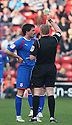 Referee Trevor Kettle books Ronnie Henry of Stevenage - Walsall v Stevenage - npower League 1 - Banks's Stadium, Walsall - 24th March, 2012  .© Kevin Coleman 2012