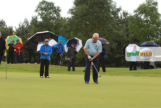 Martin Darcy (Tullamore) on the 15th green with a putt to win the Final round of the Irish Mixed Foursomes Leinster Final at Millicent Golf Club, Clane, Co. Kildare. 06/08/2017<br /> Picture: Golffile | Thos Caffrey<br /> <br /> <br /> All photo usage must carry mandatory copyright credit     (&copy; Golffile | Thos Caffrey)