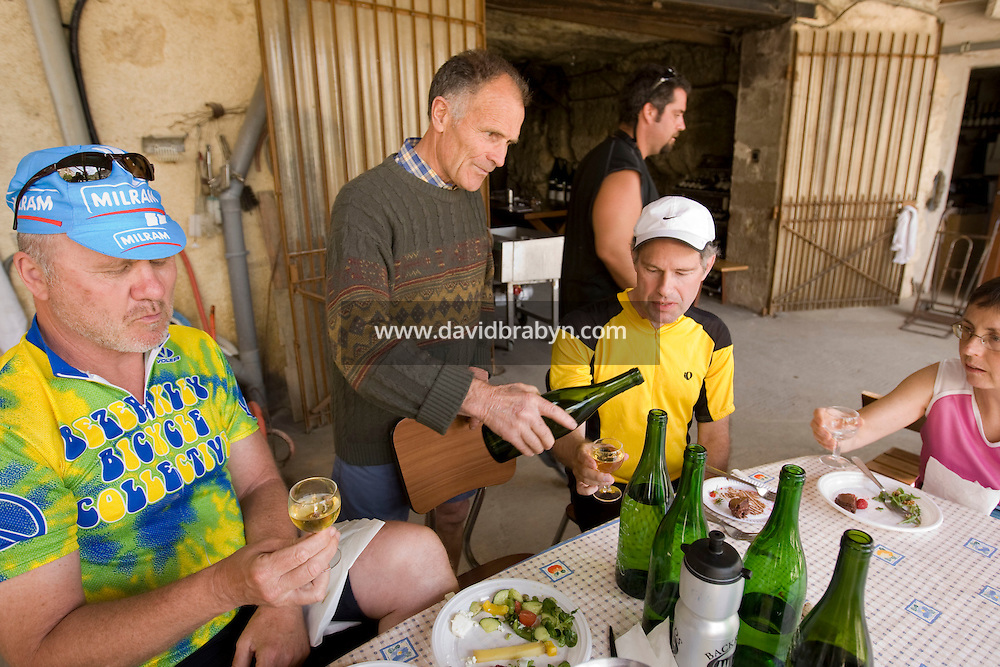 Winemaker Daniel Jarry serves wine to participants in a Backroads cycle tour of the Loire Valley at his cellars in Vouvray, France, 26 June 2008.
