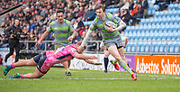 Newcastle Falcons' Simon Hammersley evades the tackle of Exeter Cheifs' Jack Innard to score his side's second try<br /> <br /> Photographer Bob Bradford/CameraSport<br /> <br /> Anglo Welsh Cup Semi Final - Exeter Chiefs v Newcastle Falcons - Sunday 11th March 2018 - Sandy Park - Exeter<br /> <br /> World Copyright &copy; 2018 CameraSport. All rights reserved. 43 Linden Ave. Countesthorpe. Leicester. England. LE8 5PG - Tel: +44 (0) 116 277 4147 - admin@camerasport.com - www.camerasport.com