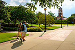 A group of friends crosses the Quad on a sunny afternoon. Photo by Robert Jordan/Ole Miss Communications
