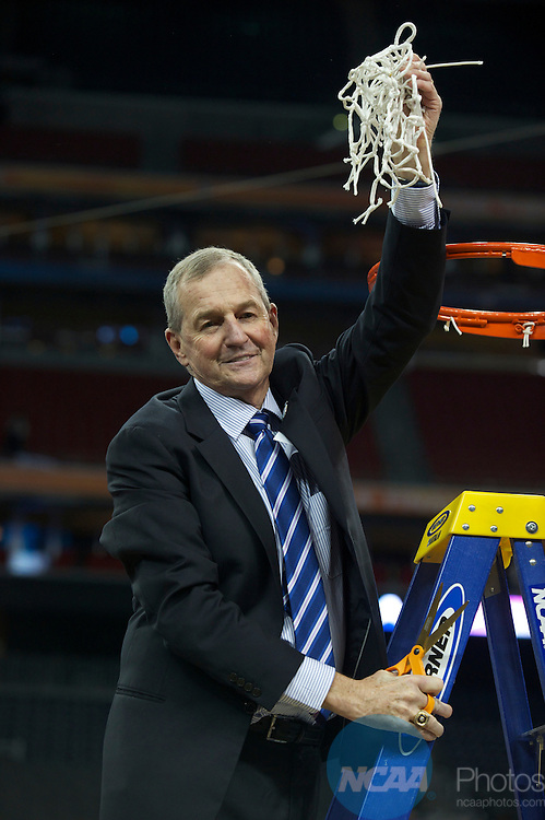 2011 APR 04: Head coach Jim Calhoun of Connecticut cuts down the net following the 2011 NCAA Division I Men's Final Four Championship game held in Reliant Stadium in Houston, TX. UConn went on to defeat Butler 53-41 to claim the championship title.  Ryan McKee/NCAA Photos