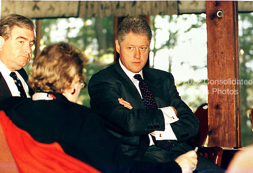 United States President Bill Clinton meets with his Foreign Policy Team on Thursday, October 22, 1998 at The Washington Summit at Wye River. Clockwise from left to right: U.S. Secretary of State Madeleine Albright; Sandy Berger, National Security Advisor; President Clinton..Mandatory Credit: White House via CNP