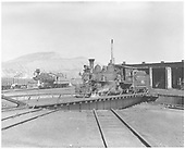 RGS 4-6-0 #20 on turntable at Durango roundhouse with D&amp;RGW #473 in background.<br /> RGS  Durango, CO  6/4/1951