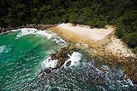 Aerial view of a tropical beach, green sea and rainforests on the Ilha Grande island. Angra dos Reis, Rio de janeiro, Brazil. Wednesday, Nov. 15, 2006.
