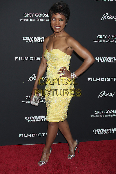 "Angela Bassett.""Olympus Has Fallen"" Los Angeles Premiere held at ArcLight Cinemas Cinerama Dome, Hollywood, California, USA..March 18th, 2013.full length dress yellow strapless lace    silver shoes clutch bag hand on hip side .CAP/ADM/RE.©Russ Elliot/AdMedia/Capital Pictures."