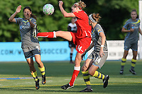 WNY Flash midfielder, Becky Edwards (14) bikes the ball between Philadelphia Indpendence midfielders Christina DiMartino (5) and Sinead Farrelly (14).  The Philadephia Independence dropped a 2-1 decision to the Western New York Flash on Memorial Day weekend at Widener University in Chester, PA.