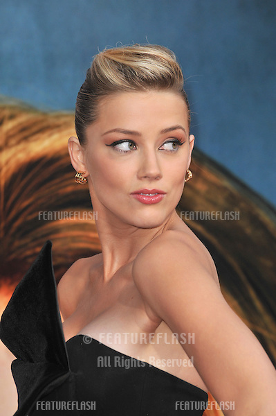 Amber Heard at the premiere of her new movie Pineapple Express at the Mann Village Theatre, Westwood..July 31, 2008  Los Angeles, CA.Picture: Paul Smith / Featureflash