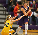 SIOUX FALLS, SD - DECEMBER 31: Augusta Thramer #3 from the University of Sioux Falls controls the ball as 	Logan O'Farrell #30 from Augustana University reaches in during their game Sunday afternoon December 31, 2017 at the Stewart Center in Sioux Falls. (Photo by Dave Eggen/Inertia)