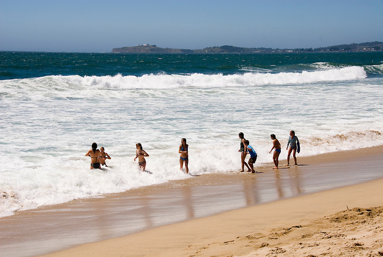 People enjoying the beach at Half Moon Bay Beach,.San Mateo Coast of California, south of San Francisco.  Photo copyright Lee Foster, 510-549-2202, lee@fostertravel.com, www.fostertravel.com. Photo 446-31174.