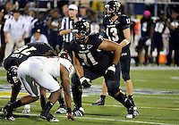 Florida International University football player offensive lineman Caylin Hauptmann (71) plays against Troy University on October 26, 2011 at Miami, Florida. FIU won the game 23-20 in overtime. .