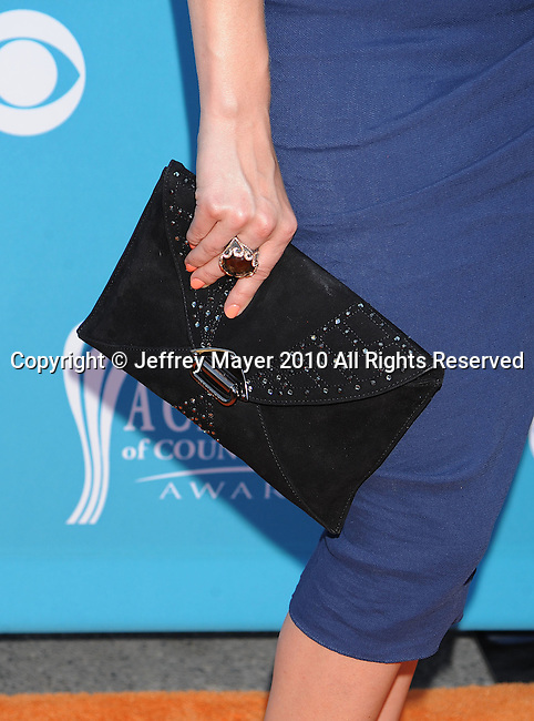 LAS VEGAS, Nevada - April 18: Singer LeAnn Rimes's purse and jewelry at the 45th Annual Academy of Country Music Awards at the MGM Grand Garden Arena on April 18, 2010 in Las Vegas, Nevada.