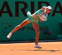 Petra Martic (CRO) against Elena Dementieva (RUS) (5) in the first round of the women's singles. Elena Dementieva beat Petra Malic 6-1 6-1..Tennis - French Open - Day 2 - Mon 24 May 2010 - Roland Garros - Paris - France..© FREY - AMN Images, 1st Floor, Barry House, 20-22 Worple Road, London. SW19 4DH - Tel: +44 (0) 208 947 0117 - contact@advantagemedianet.com - www.photoshelter.com/c/amnimages