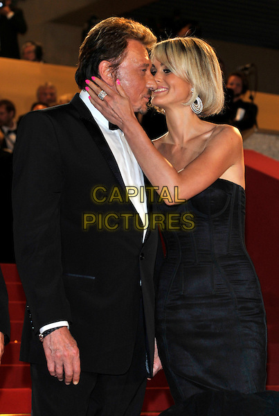 JOHNNY HALLYDAY, LAETITIA HALLYDAY.'Vengance' screening.62nd International Cannes Film Festival.Cannes, France. 17th May 2009.half length married husband wife  strapless black dress bustier tux bow tie tuxedo kissing hand ring .CAP/PL.©Phil Loftus/Capital Pictures