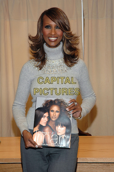 """IMAN.Signs copies of her new book, """"The Beauty Of Color"""" at the Barnes & Noble Bookstore on 5th Avenue in Manhattan, New York, New York. .October 17th, 2005.Photo Credit: Patti Ouderkirk/AdMedia/Capital Pictures.Ref: PO/ADM.half length grey gray sweater turtleneck polo neck .www.capitalpictures.com.sales@capitalpictures.com.© Capital Pictures."""