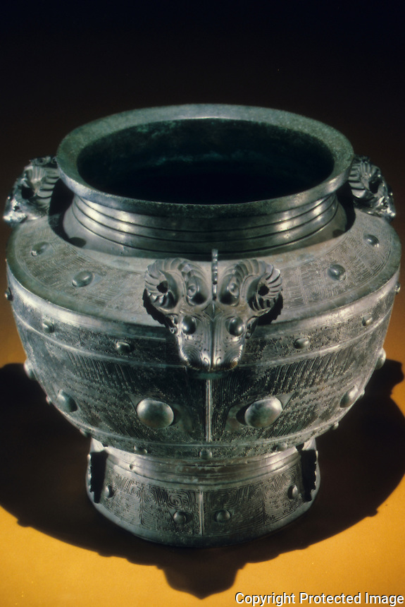 "China:  Bronze wine vessel (lei), Shang Dynasty. 13th -11th C. B.C. 20 1/2 ""  high.  Palace Museum, Beijing. Great Bronze Age of China, exhibition."