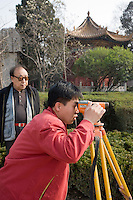 Surveyor at work at the Forest of Stone Tablets, Xian, China