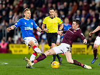 26th January 2020, Tynecastle Park, Edinburgh, Scotland; Scottish Premier League football, Hearts of Midlothian versus Rangers; Jon Souttar of Hearts slides in to tackle Scott Arfield of Rangers