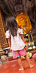 Young Cambodian girl at the Ya-Tep Shrine, Royal Independence Gardens, Siem Reap, Cambodia