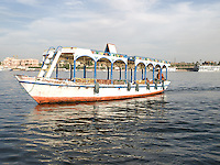 A colorful boat navigating on the Nile. Luxor, Egypt. Year: 2009.