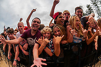 A crowd of teenagers listen to rock music at a concert on the beach during the Australian Open of Surfing, Manly Beach, Sydney, New South Wales, Australia