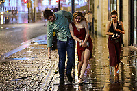 Pictured: A young couple walk on the edge of the pavement. Sunday 31 December 2017 and 01 January 2018<br /> Re: New Year revellers in Wind Street, Swansea, Wales, UK