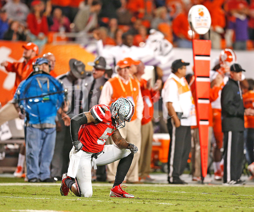 Ohio State Buckeyes quarterback Braxton Miller (5) reacts to a third quarter interception that lead to a Clemson TD at the 2014 Discover Orange Bowl at Sun Life Stadium in Miami Gardens, Florida on January 3, 2014. (Chris Russell/Dispatch Photo)