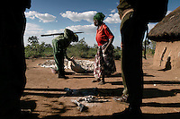 Old woman with bits of bush meat is boke Mwita and the village is Bisarara. .Paul Jones (the Jones of Dow Jones) has pumped 20 million dollars into Grumeti Reserve and conservation efforts to date and has nothing yet that will recoup that money.  Before he can bring wealthy tourists in on their lear jets, he has to bring the animals back into Grumeti Reserve.  To do that, he and his team are doing everything right for conservation.  The human bycatch from their private army of anti-poaching team is another story, but in terms of conservation, they are doing a great job.  ..Their anti poaching effort has probably just moved the big-time poachers elsewhere.  This private army has no authority to do house to house searches, but they do anyway.  Money talks and this army brings a local policeman and Park Ranger in tow.  If the policeman discovers a little marijuana, it can mean 6 months in jail for the offender... Even though everyone knows all the Wakuria grow pot... The private army has been so effective, however, that the wildlife probably will come back to where the wealthy tourists can view it from their infinity-edge pool at their $2000 a night luxury home.  But the human bycatch is too severe and hostility is building up in the communities...The Grumeti Reserves are trying to reshape the entire northeast corner of the park area.  They hire 1400 workers from the neighboring communities and have an extensive outreach program.  They are trying to create programs where they can replace the protein lost from their crack down on poaching.  They have a fish farm program with the Heifer project that allows folks to farm Tilapia.  They also employ only people from the local villages to do construction. They are developing a five star hotel and an exclusive camp that will cost 1500 to $2000 a night and only put 40 more tourists a day into the park.  Albeit by helicopter.  They are pumping money back into the community (unlike the Masai situation) and have to according to T